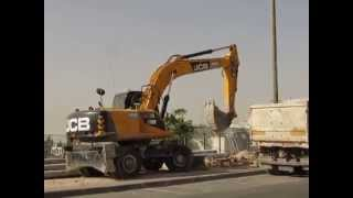 JCB wheel bagger Tractor loading rocks to a Dump Truck טרקטור 3