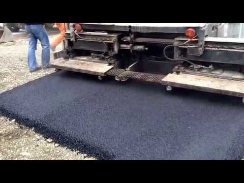 Paving the road with asphalt