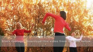 Group of focused women in sportswear dancing in autumn park