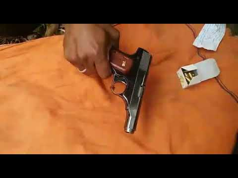 .32 Pistol shooting for coconut