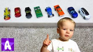 Alex playing with toy Cars and Learns color