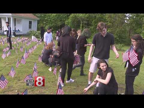 Students at Waterbury school plant flags for Memorial Day