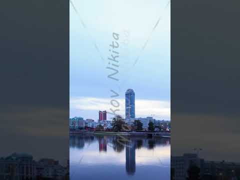 Vertical video. Sunrise on the waterfront. Ekaterinburg, Russia. Time Lapse