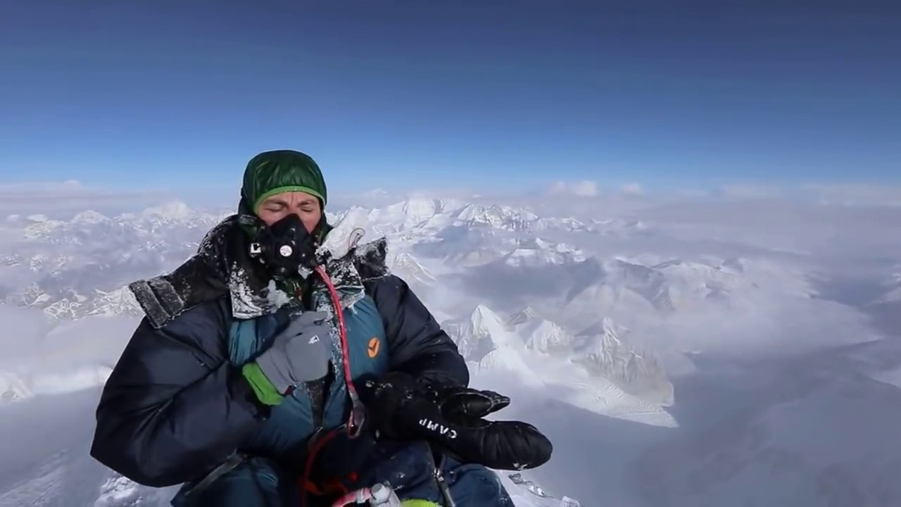 Scott Mackenzie stands on the Summit of Everest