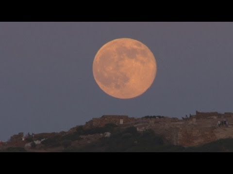 Supermoon lights up the sky over ancient Greek temple and around the world
