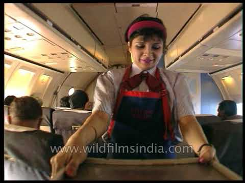 Air Hostesses serve drinks on Indian private airline flight - is that beer or apple juice?