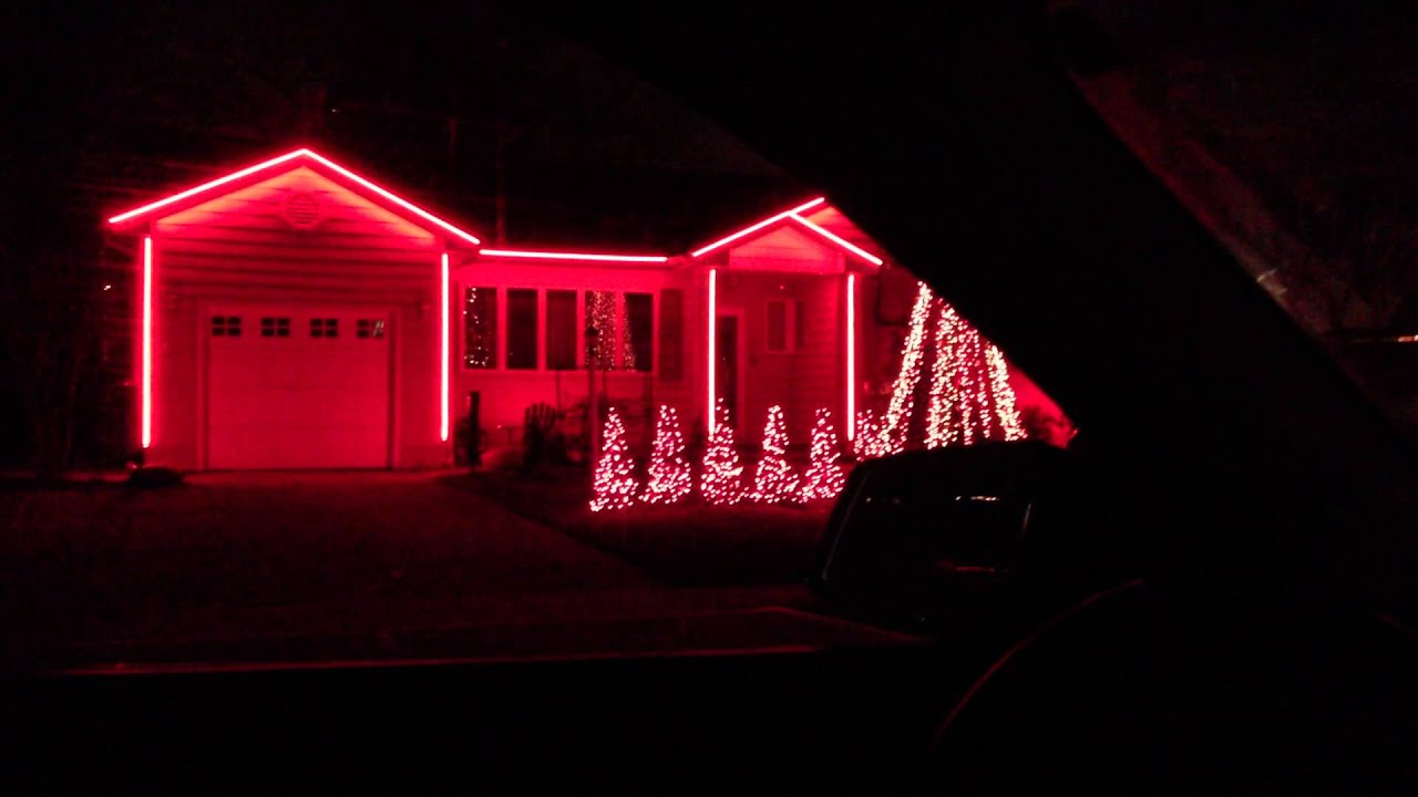 Crazy christmas lights on house move to music nutcracker for Orchestra house