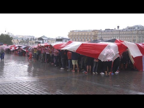 Croatian Fans Hide Under GIANT Flag During Heavy Rain In Moscow - Russia 2018 World Cup