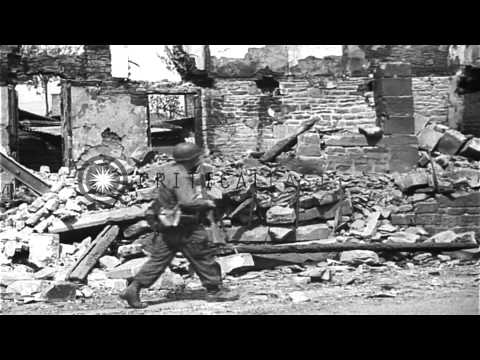 United States 4th Infantry Division troops walk through a rubbled  village in Fra...HD Stock Footage