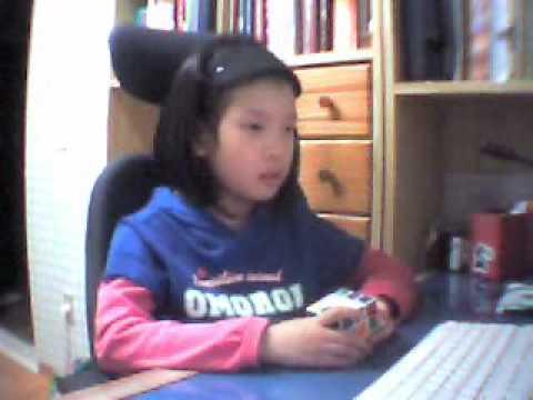 Kid Solves Rubik S Cube Blindfolded