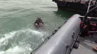Navy Divers Inspect Barge For Underwater Explosives Off Coast of Bahrain