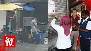Worker caught in fish smashing act in back alley of Kota Kemuning restaurant