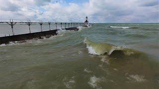 Windy Lighthouse Lake Michigan Amazing Aerial video