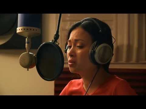 Ha Phuong in the recording studio singing