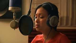Ha Phuong in the recording studio singing