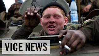 Ukrainian Military Give Up Their Weapons: Russian Roulette