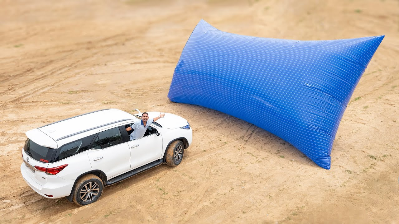 Download Driving Fortuner On World's Biggest Pillow