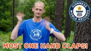 Most alternate one-handed claps in one minute - Guinness World Records