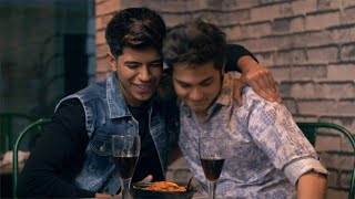 Two young teenagers chilling out together in a cafe or a lounge - lifestyle concept