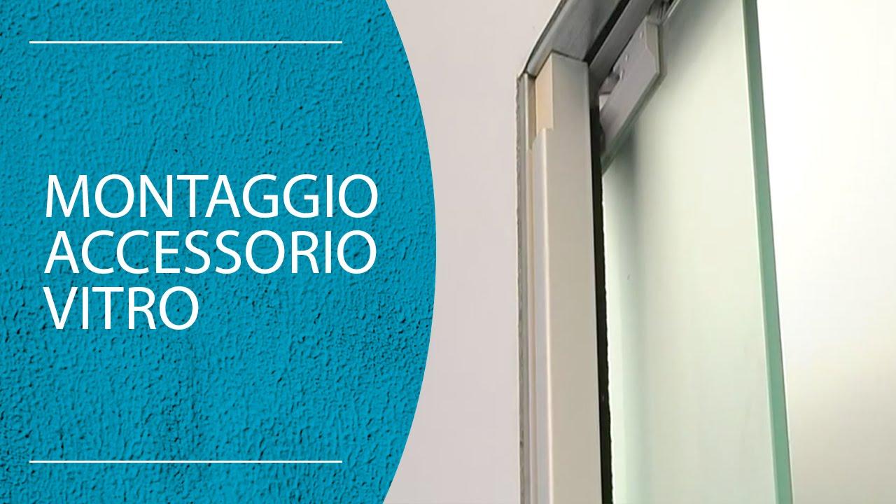 installazione vitro su porta in vetro versione per staffe
