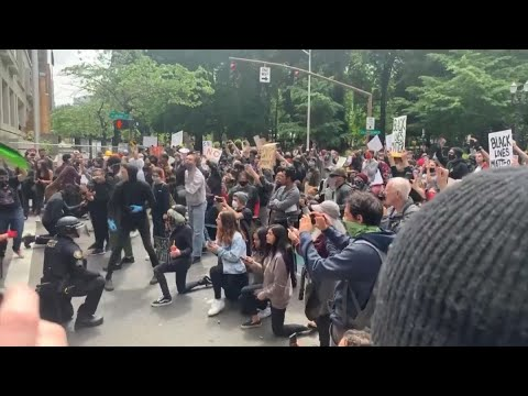 Watch: Police Kneel With Protesters In Portland