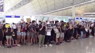 Passengers voice concerns over Hong Kong airport protests