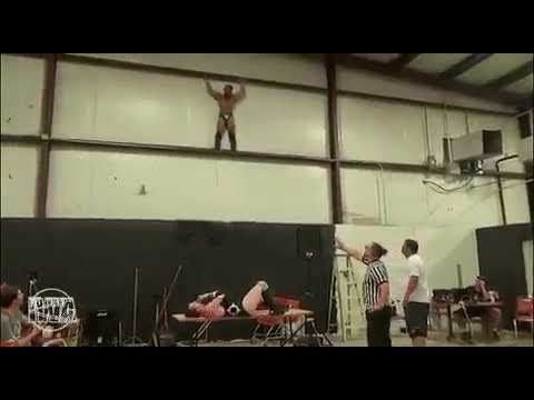 Wrestler jumps off balcony and misses the table hits cement floor!