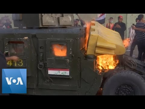 Iraqi Protesters Burn Humvee in Third Day of Protests