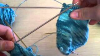 Toe up two at a time on two circular needle socks.