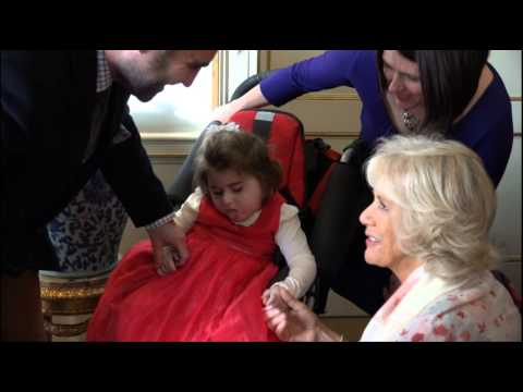 The Duchess of Cornwall invites children from Helen & Douglas House to decorate the Christmas tree