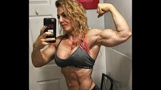 42 years young female bodybuilder Dana Shemesh flexing her hard muscles