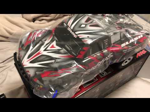 TRAXXAS SLASH 2WD HCG CHASSIS BRUSHED ELECTRIC SHORT COURSE TRUCK UNBOXING ( COMES WITH EXTRAS !)