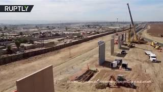 2017-10-20-12-01.Trump-s-Wall-Prototypes-spring-up-along-Mexican-border