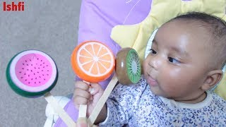 Baby Arfi loves to smile while Mummy show her fruits lollipops