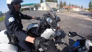 Watch 'Coolest Cop' Give Biker Fist Bump, Laugh and Warning To His Surprise