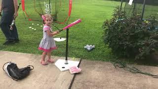 Hannah playing baseball