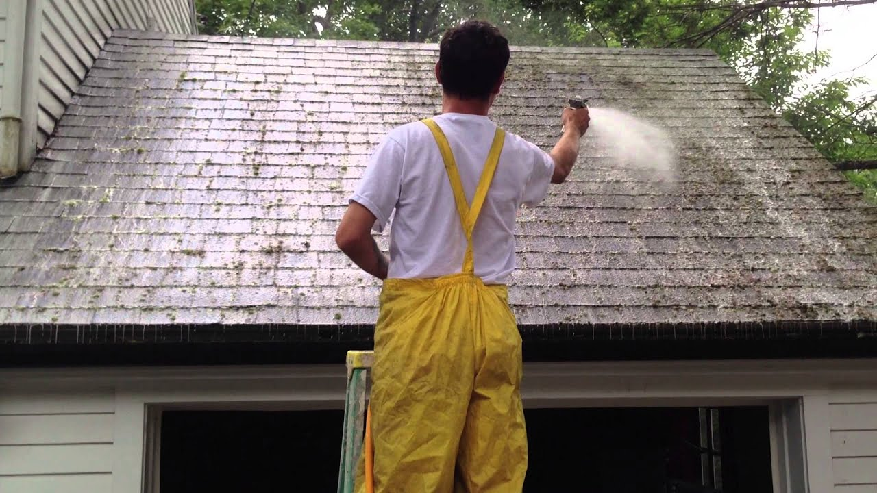 Roof Cleaning Spraying The Solution To Kill All Moss