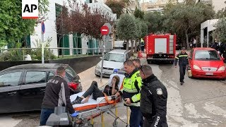 Raw Video: Scenes from hotel fire rescue in central Athens