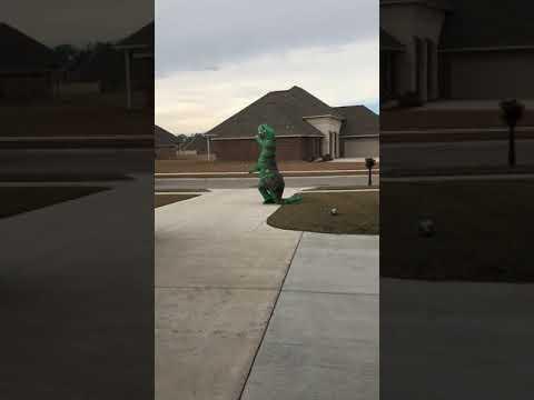 Dinosaur dad greets daughter at the bus stop