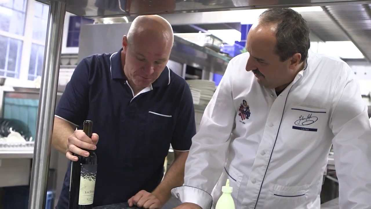 Uwe Boll shares LaStella wine with Chef Johann Lafer