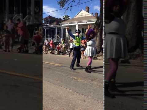 New Orleans Mardi Gras dancing cop