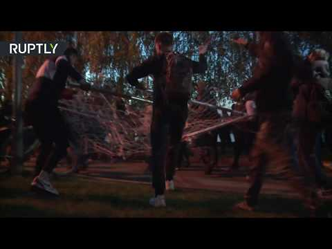 People rip fence apart in protest against building of church in a park in Ekaterinburg, Russia