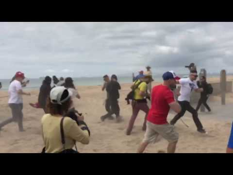 Trump Supporters and Protestors clash during Huntington Beach march