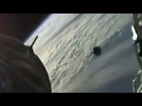 Camera catches mysterious object passing by SpaceX capsule
