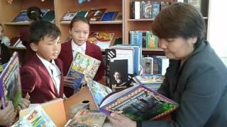 балалардың кітапханадан кітап алуы