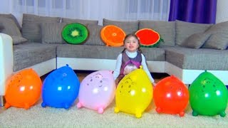 Dominika and brother play with balloons