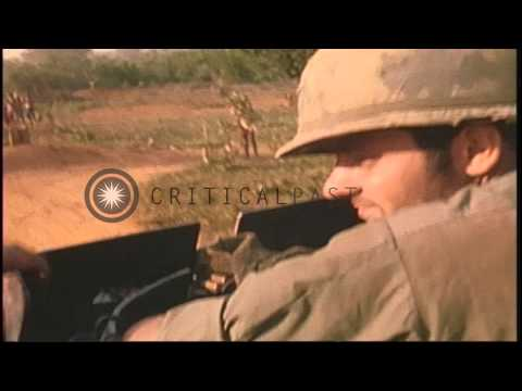 Natives wave as US 9th Infantry Division troops on M113 Armored Personnel Carrier...HD Stock Footage