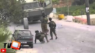 لحظة تصدي جندي اسرائيلي لاطار سيارة Video