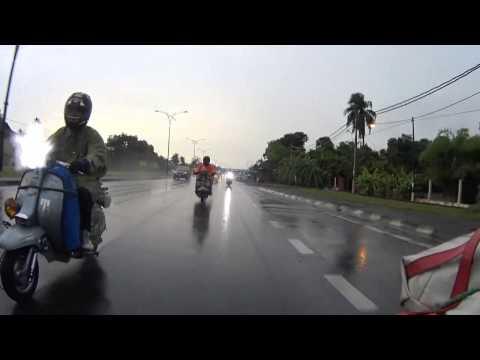 Lambretta Thailand in the rain at Perlis Malaysia