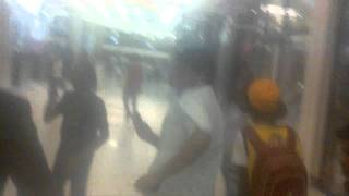 young nucho bombarded by fans while shopping at sandton mall again mistaken for lil wayne.flv